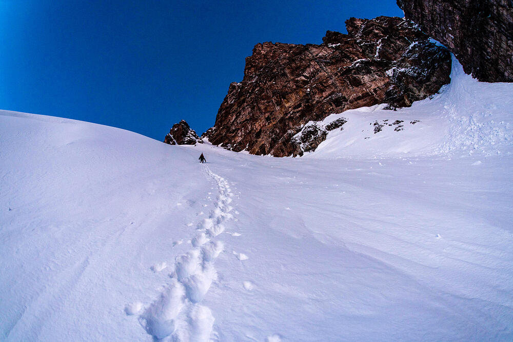 Ski mountaineering up a couloir