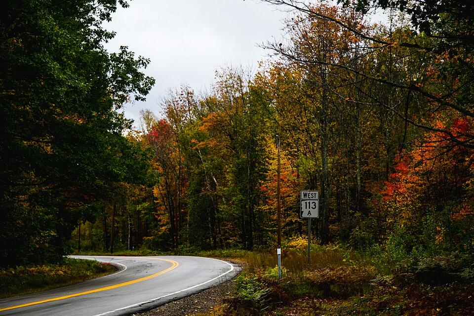 Leaf peeping in New England, curving road.