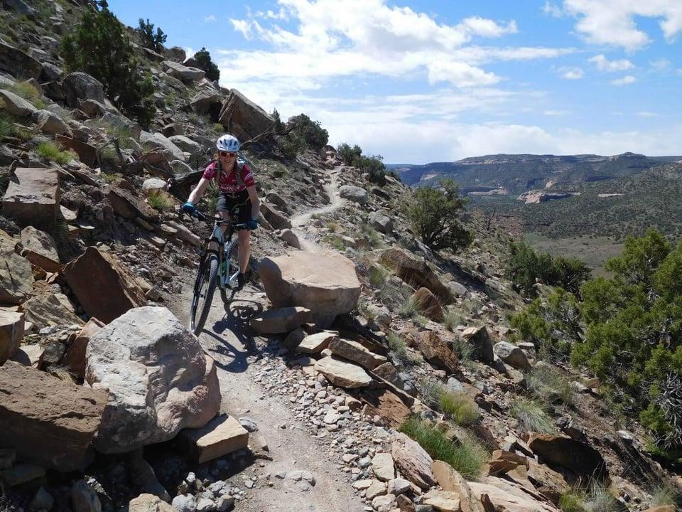 Biking along a cliff in Moab.